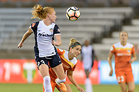 Houston, TX - Saturday July 15, 2017: Tori Huster heads the ball over Morgan Brian during a regular season National Women's Soccer League (NWSL) match between the Houston Dash and the Washington Spirit at BBVA Compass Stadium.