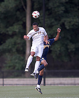 Boston College forward Charlie Rugg (17) and Quinnipiac University defender Brandon Strain-Goode (2) battle for head ball. Boston College defeated Quinnipiac, 5-0, at Newton Soccer Field, September 1, 2011.