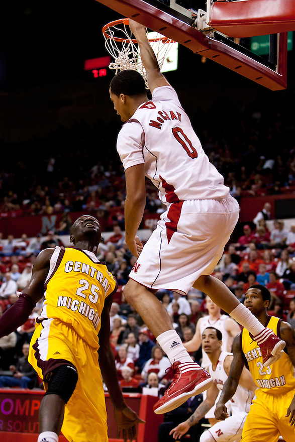 20 December 2011: Toney McCray #0 of the Nebraska Cornhuskers dunks the ball over Olivier Mbaigoto #25 of the Central Michigan Chippewas during the first half at the Devaney Sports Center in Lincoln, Nebraska. Nebraska defeated Central Michigan 72 to 69.