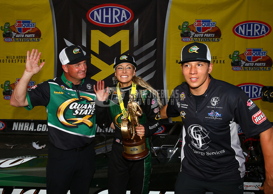 Feb 28, 2016; Chandler, AZ, USA; NHRA top fuel driver Leah Pritchett celebrates with team owner Bob Vandergriff (left) and teammate Dave Connolly after winning the Carquest Nationals at Wild Horse Pass Motorsports Park. Mandatory Credit: Mark J. Rebilas-