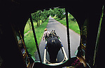 Leslie, and English Romany, leads his horse and wagon down the road. Midlands, England 2000