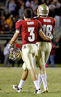 TALLAHASSEE, FL 11/19/11-FSU-UVA111911 CH-Florida State's Dustin Hopkins, center, is consoled by Justin Bright, left, after he missed the potential game winning field goal against Virginia's in the final seconds of the game Saturday at Doak Campbell Stadium in Tallahassee. The Seminoles lost to the Cavaliers 14-13..COLIN HACKLEY PHOTO