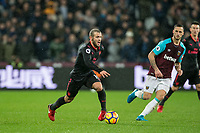 Jack Wilshere of Arsenal & Marko Arnautovic of West Ham United during the Premier League match between West Ham United and Arsenal at the Olympic Park, London, England on 13 December 2017. Photo by Andy Rowland.