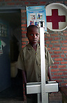 A 12-year boy on the weight scale before the medical consultation at the Ntikaro health centre, district of Burera, Rwanda