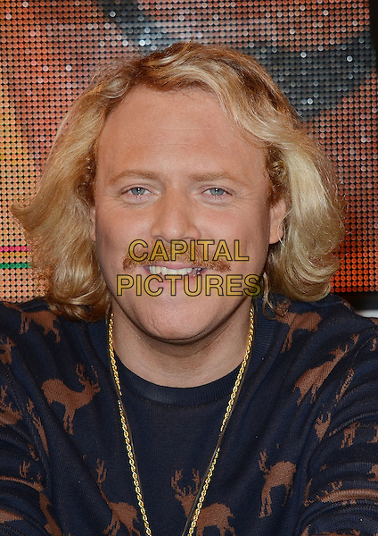 Keith Lemon (Leigh Francis).The stars meet fans and sign copies of the new 'Celebrity Juice: Too Juicy For TV 2' DVD at HMV, Oxford Street..London, England, UK, .22nd November 2012.portrait headshot blue brown stag print top gold necklace facial hair moustache mustache.CAP/WIZ.© Wizard/Capital Pictures.