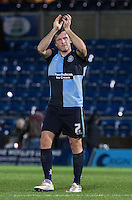 Goal scorer Garry Thompson of Wycombe Wanderers applauds the supporters during the Sky Bet League 2 match between Wycombe Wanderers and Portsmouth at Adams Park, High Wycombe, England on 28 November 2015. Photo by Andy Rowland.