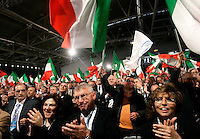 Delegati sventolano bandiere tricolori durante la seconda giornata del congresso fondativo del PdL, partito del Popolo della Liberta', alla Nuova Fiera di Roma, 28 marzo 2009..Delegates wave tricolour flags during the Foundation Congress of the People of Freedom center right party in Rome, 28 march 2009..UPDATE IMAGES PRESS/Riccardo De Luca