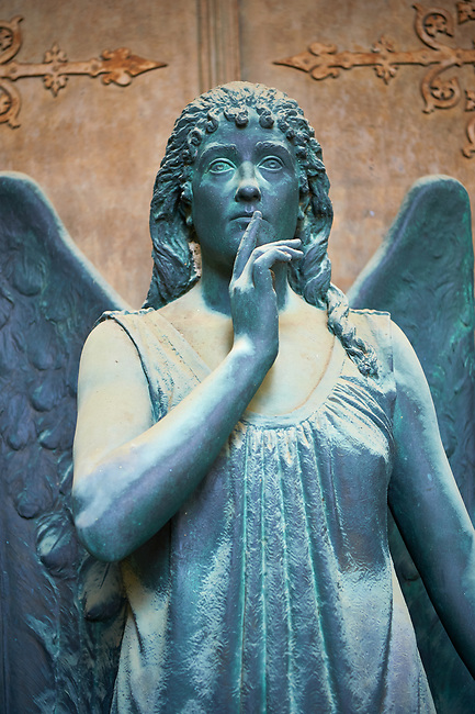 Pictures of a bronze sculptured angel,  monumental De Bernardi tomb, Staglieno Monumental Cemetery, Genoa, Italy