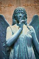 Pictures of a bronze sculptured angel,  monumental De Bernardi tomb, Staglieno Monumental Cemetery, Genoa, Italy