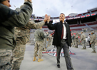 Ohio State Buckeyes head coach Urban Meyer high fives U.S. Army National Guard members while entering the stadium as part of Military Appreciation Night prior to the NCAA football game at Ohio Stadium on Nov. 1, 2014. (Adam Cairns / The Columbus Dispatch)