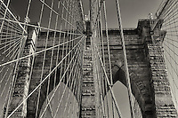 Looking through the cables at Brooklyn Bridge in NYC in Black and white.