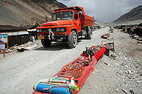 China started building a controversial 67-mile &quot;paved highway fenced with undulating guardrails&quot; to Mount Qomolangma, known in the west as Mount Everest, to help facilitate next year's Olympic Games torch relay./// A truck rolls through the tent village guesthouses at Everest Base Camp.<br /> Tibet, China<br /> July, 2007