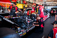 Oct 14, 2019; Concord, NC, USA; Crew members work on the car of NHRA top fuel driver Doug Kalitta during the Carolina Nationals at zMax Dragway. Mandatory Credit: Mark J. Rebilas-USA TODAY Sports