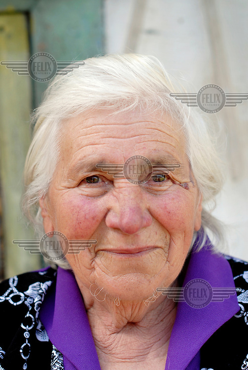 83 year old Maria Azevich, long time resident of the village of Ust-Byur, where many white Russians were exiled in the early 1920s.