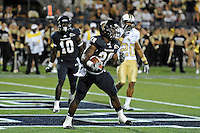 17 September 2011:  FIU running back Darriet Perry (28) celebrates his touchdown in the third quarter as the FIU Golden Panthers defeated the University of Central Florida Golden Knights, 17-10, at FIU Stadium in Miami, Florida.