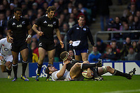Kieran Read of New Zealand scores a try despite a valiant effort by Alex Corbisiero of England during the QBE Autumn International match between England and New Zealand at Twickenham on Saturday 01 December 2012 (Photo by Rob Munro)