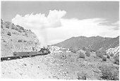 Unidentified K-28 leading a freight consist up Barranca Hill.  View is from the rear of the train, so it may be a mixed #425.<br /> D&amp;RGW  Barranca Hill, NM