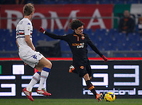 Calcio, ottavi di finale di Coppa Italia Tim: Roma vs Sampdoria. Roma, stadio Olimpico, 9 gennaio 2014.<br /> AS Roma defender Dodo', of Brazil, is challenged by Sampdoria defender Bartosz Salamon of Poland, left, during the Italy Cup round of sixteen football match between AS Roma and Sampdoria at Rome's Olympic stadium, 9 January 2014.<br /> UPDATE IMAGES PRESS/Isabella Bonotto