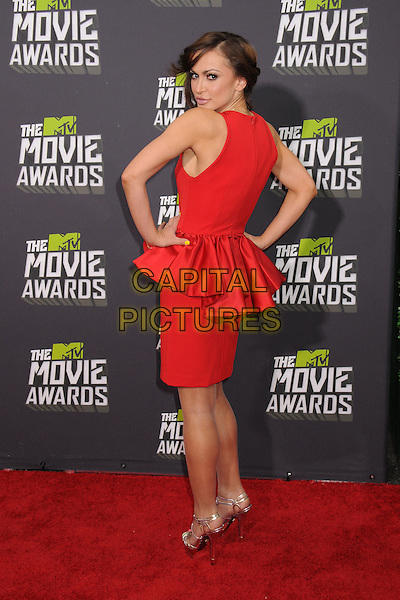 Karina Smirnoff.2013 MTV Movie Awards - Arrivals held at Sony Pictures Studios, Culver City, California, USA..14th April  2013.full length red sleeveless dress peplum hands on hips back behind rear looking over shoulder.CAP/ADM/BP.©Byron Purvis/AdMedia/Capital Pictures