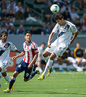 CARSON, CA - March 17, 2013: LA Galaxy defender Omar Gonzalez (4) heads the ball during the LA Galaxy vs Chivas USA game at the Home Depot Center in Carson, California. Final score LA Galaxy 1, Chivas USA 1.