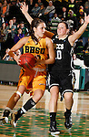 JANUARY 23, 2015 -- Chelsey Biegler #22 of Black Hills State drives past Jessika Kienitz #10 of UC-Colorado Springs during their Rocky Mountain Athletic Conference women's basketball game Friday at the Donald E. Young Center in Spearfish, S.D. (Photo by Dick Carlson/Inertia)
