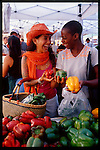 two women friends shopping for fresh produce at the farmers' market in Santa Monica, California