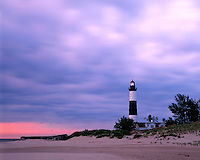 Sunset light on Big Sable Point Lighthouse on the shore of Lake Michigan; Ludington State Park, MI
