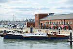 Pictured: Steam Pinnace 199<br /> <br /> The last surviving steam pinnace, Pinnace 199, at its berth at the historic dockyard in Portsmouth, Hampshire.  <br /> <br /> An historic 100 year old Royal Navy steam ship has finally been returned to its former glory after a painstaking restoration process.<br /> <br /> The 50ft-long Steam Pinnace 199 is believed to be the last remaining boat of its type in operational service.<br /> <br /> For years, the significance of the boat, which was built in 1911, was lost on various owners and it languished at the side of the Thames for more than 20 years as a static houseboat.<br /> <br /> Her steam engine was even replaced by a petrol engine.<br /> <br /> However, before the vessel disappeared forever beneath a Thames mud bank, she was recognised for the proud little ship she once was and rescued by a group of volunteers, who called themselves Group 199.   SEE OUR COPY FOR DETAILS.<br /> <br /> <br /> <br /> © Morten Watkins/Solent News & Photo Agency<br /> UK +44 (0) 2380 458800