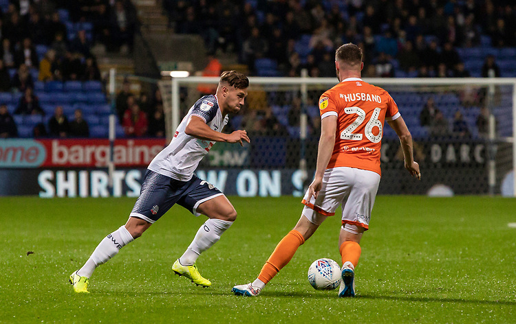 Bolton Wanderers' Dennis Politic competing with Blackpool's James Husband (right) <br /> <br /> Photographer Andrew Kearns/CameraSport<br /> <br /> The EFL Sky Bet League One - Bolton Wanderers v Blackpool - Monday 7th October 2019 - University of Bolton Stadium - Bolton<br /> <br /> World Copyright © 2019 CameraSport. All rights reserved. 43 Linden Ave. Countesthorpe. Leicester. England. LE8 5PG - Tel: +44 (0) 116 277 4147 - admin@camerasport.com - www.camerasport.com