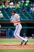 Montgomery Biscuits third baseman Michael Russell (12) follows through on a swing during a game against the Mississippi Braves on April 25, 2017 at Montgomery Riverwalk Stadium in Montgomery, Alabama.  Mississippi defeated Montgomery 3-2.  (Mike Janes/Four Seam Images)