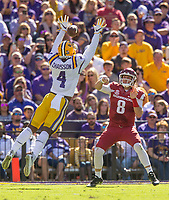 NWA Democrat-Gazette/BEN GOFF @NWABENGOFF<br /> Austin Allen (8), Arkansas quarterback, throws the ball between the arms of K'Lavon Chaisson, LSU linebacker, in the second quarter Saturday, Nov. 11, 2017 at Tiger Stadium in Baton Rouge, La.
