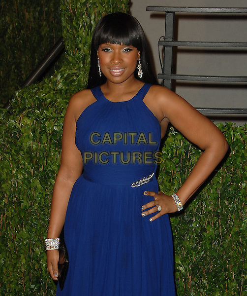 JENNIFER HUDSON.The 2010 Vanity Fair Oscar Party held at The Sunset Tower Hotel in West Hollywood, California, USA..March 7th, 2010.oscars half length blue fringe bangs hair eyeshadow make-up beauty dangling silver earrings hand on hip dress bracelets.CAP/RKE/DVS.©DVS/RockinExposures/Capital Pictures.