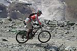 Mountain biker ascends via the Gornergrat train and descends past the Matterhorn, above Zermatt, Switzerland.
