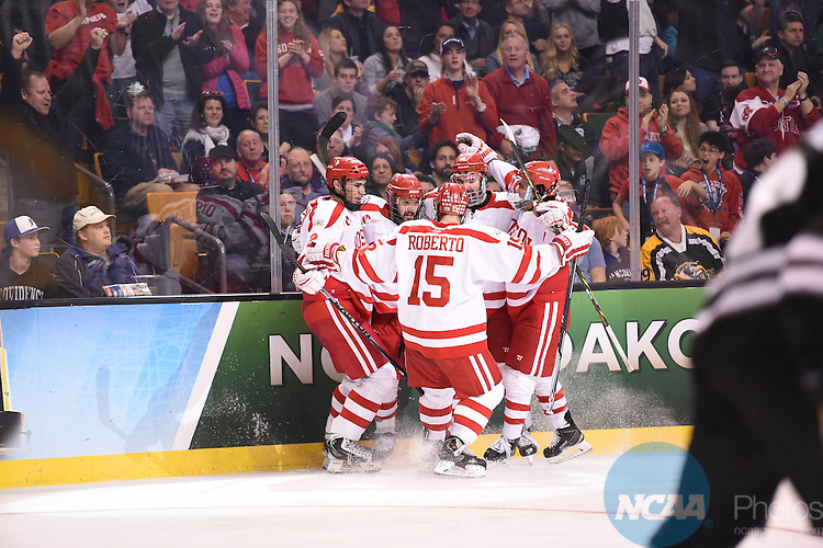 11 APR 2015: Boston University teammates celebrate after a goal during the Division I Men's Ice Hockey Championship held at the TD Garden in Boston, MA. Providence defeated Boston 4-3 for the national title. Brian Babineau/NCAA Photos