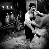 The man fighting in this picture is one of the organisers of the fight club. One of the reasons he set up the club is because it is the antithesis of what society expects and wants from him. 'Gentlemen's Fight Clubs' are held in private garages or homes. People who work as software engineers and programmers during the day meet there to fight. This way they are able to let out their tensions, frustrations and passions in somtimes overtly violent ways. The participants are known to use keyboards, dustbusters and rolled up women's magazines in their fights. Silicon Valley, California.