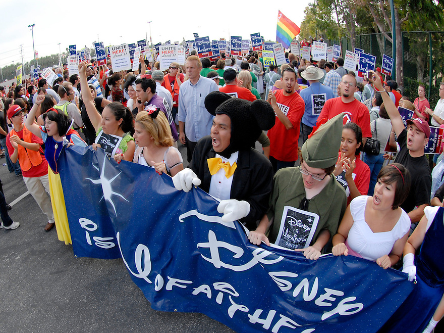 Protesters dressed as Disney characters lead a march from the Paradise Pier Hotel to the main entrance of Disney Land during a demonstration protesting Disney's treatment of hotel workers in Anaheim, Calif., on Thursday, Aug. 14, 2008.
