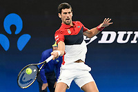 11th January 2020; Sydney Olympic Park Tennis Centre, Sydney, New South Wales, Australia; ATP Cup Australia, Sydney, Day 9; Serbia versus Russia;  Novak Djokovic versus Daniil Medvedev; Novak Djokovic of Serbia hits a forehand to Daniil Medvedev of Russia - Editorial Use