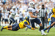 Landover, MD - September 23, 2016: BYU Cougars wide receiver Talon Shumway (82) breaks the West Virginia Mountaineers defender tackle during game between BYU and WVA at  FedEx Field in Landover, MD.  (Photo by Elliott Brown/Media Images International)
