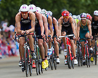07 AUG 2012 - LONDON, GBR - Stuart Hayes (GBR) of Great Britain (left) leads the front pack during the bike at the men's London 2012 Olympic Games Triathlon in Hyde Park, London, Great Britain .(PHOTO (C) 2012 NIGEL FARROW)