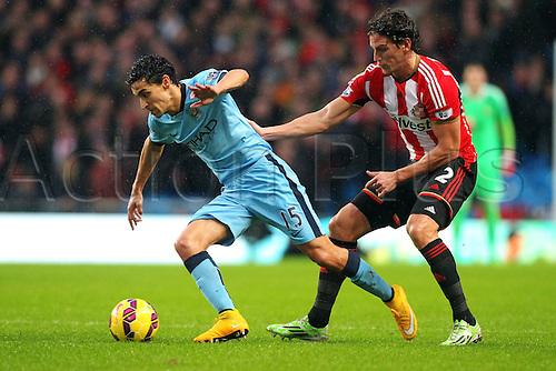 01.01.2015.  Manchester, England. Barclays Premier League. Manchester City versus Sunderland. Manchester City midfielder Jesus Navas evades Sunderland defender Billy Jones