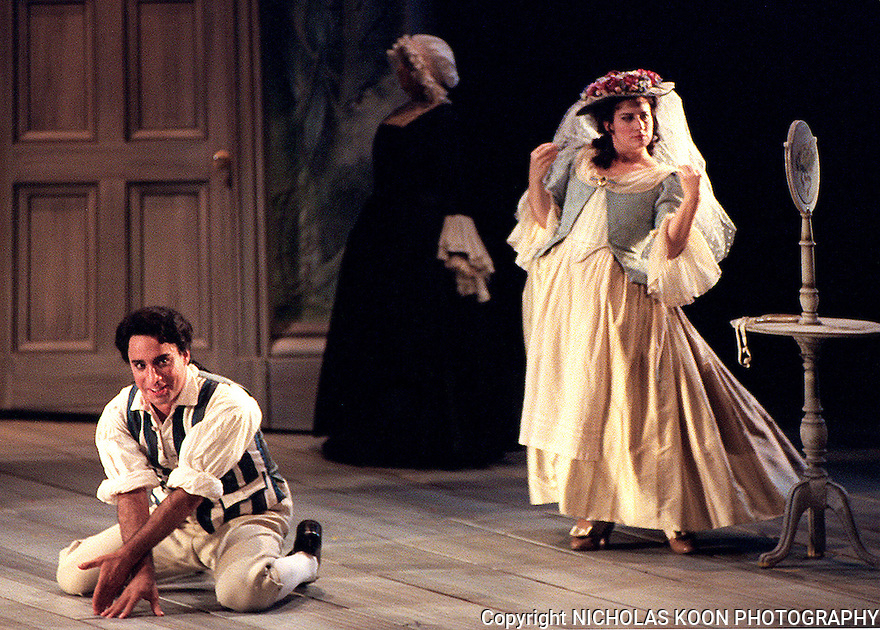 2000 - THE MARRIAGE OF FIGARO - While figaro (Richard Bernstein) measures the room to make sure the bed fits, Susanna (Christine Brandes) prepares herself for their forthcoming wedding in Opera Pacific's production of 'The Marriage of Figaro'.