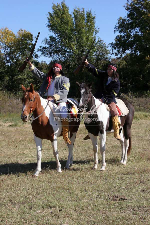 Two Apache Native American Indians on horseback holding up rifles