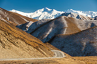 Snowy peaks rise above the Lindis pass highway (SH8). Winter Central Otago New Zealand.