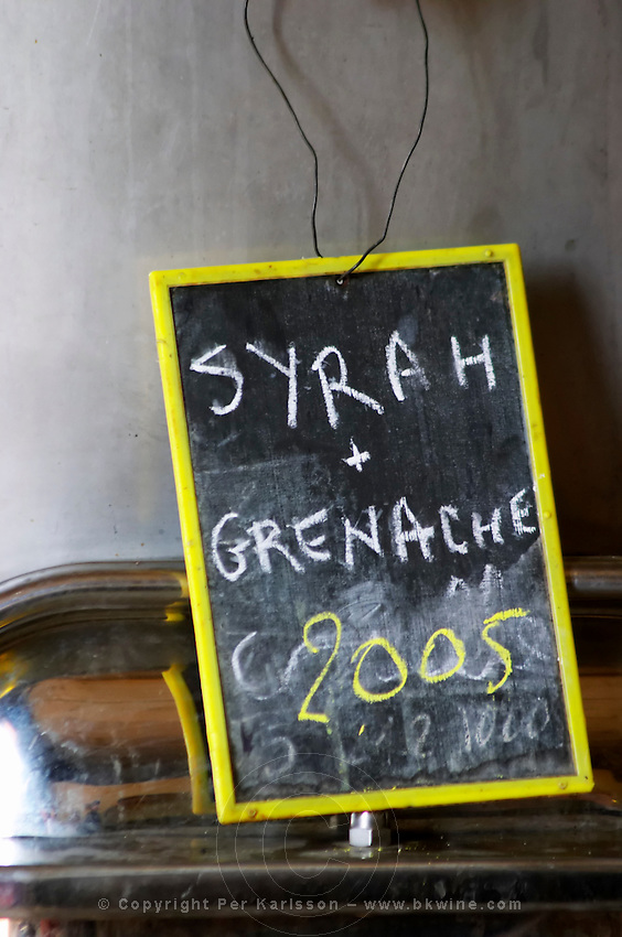Syrah and Grenache 2005. Chateau St Jean d'Aumieres, Gignac village. Terrasses de Larzac. Languedoc. Sign on tank. Stainless steel fermentation and storage tanks. France. Europe.