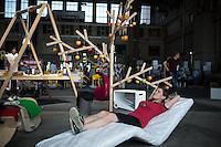 Berlin, Eine Besucherin beim DMY International Design Festival, am Freitag (07.06.13) in ehemaligen Flughafen Tegel. Festival findet von Mittwoch (05.06.13) bis Sonntag (09.06.13) statt. Foto: Maja Hitij/CommonLens