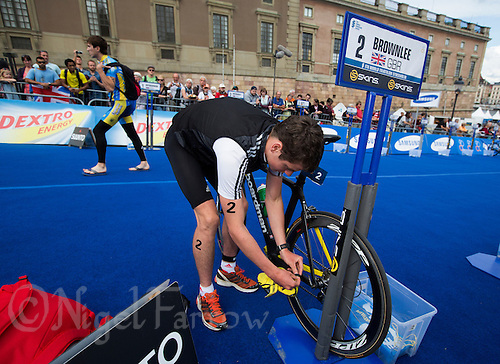 25 AUG 2012 - STOCKHOLM, SWE - Jonathan Brownlee (GBR) of Great Britain prepares in transition for the start of the elite men's 2012 ITU World Triathlon Series round in Gamla Stan, Stockholm, Sweden .(PHOTO (C) 2012 NIGEL FARROW)