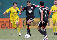 WASHINGTON, DC - AUGUST 4, 2012:  Branko Boskovic (8) of DC United breaks away from Milovan Mirosevic (10) of the Columbus Crew during an MLS match at RFK Stadium in Washington DC on August 4. United won 1-0.