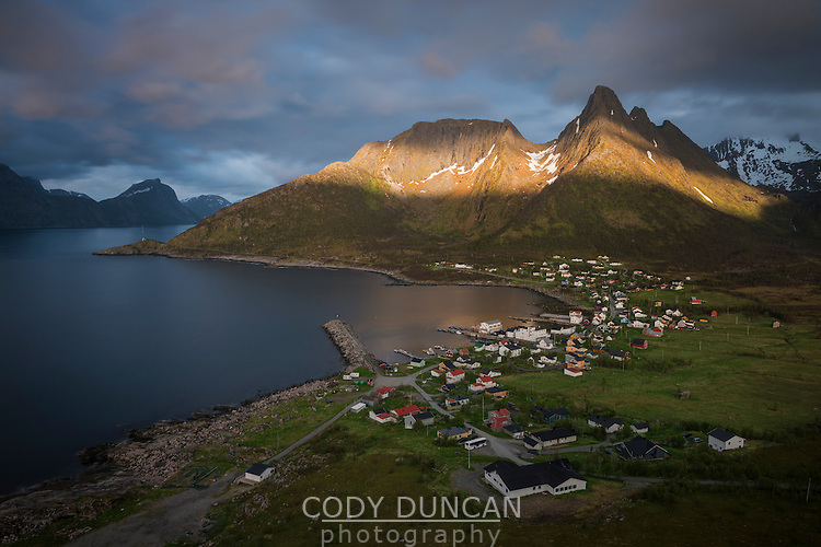 Summer light over mountains above village of Mefjordvær, Senja, Norway
