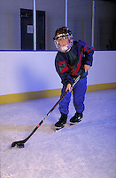 Young ice hockey player shows style