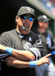20 June 2010: Chicago White Sox' Manager Ozzie Guillen looks out from the dugout prior to a game against the Washington Nationals at Nationals Park in Washington, DC. The White Sox swept the Nationals winning 6-3 in the last game of their 3-game interleague series. Mandatory Credit: Ed Wolfstein Photo